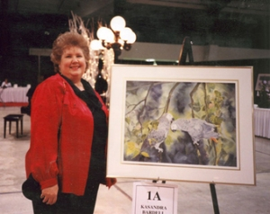 KASANDRA BARDELL Canadian painter with one of her unique creations.  www.okanaganartistsofcanada.com